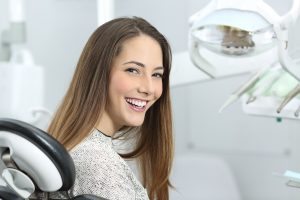 Woman smiling in a dentist's office on dental chair